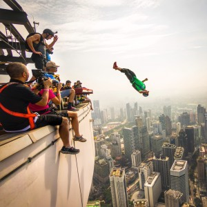 Chuma jumping from the KL tower in Malaysia. photo by Ian Flanders.